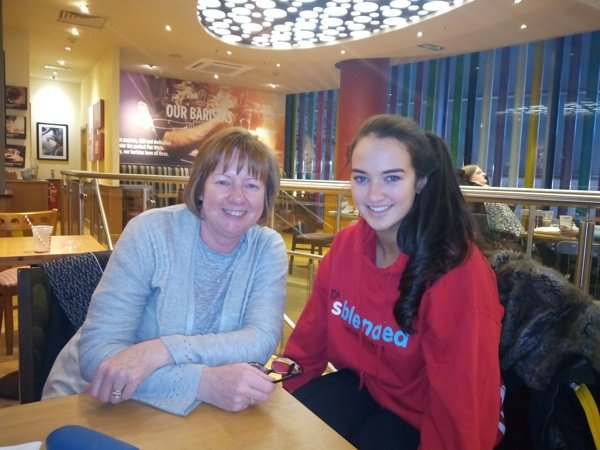 Photo of mentor Janet and mentee Lydia posing and smiling in cafe