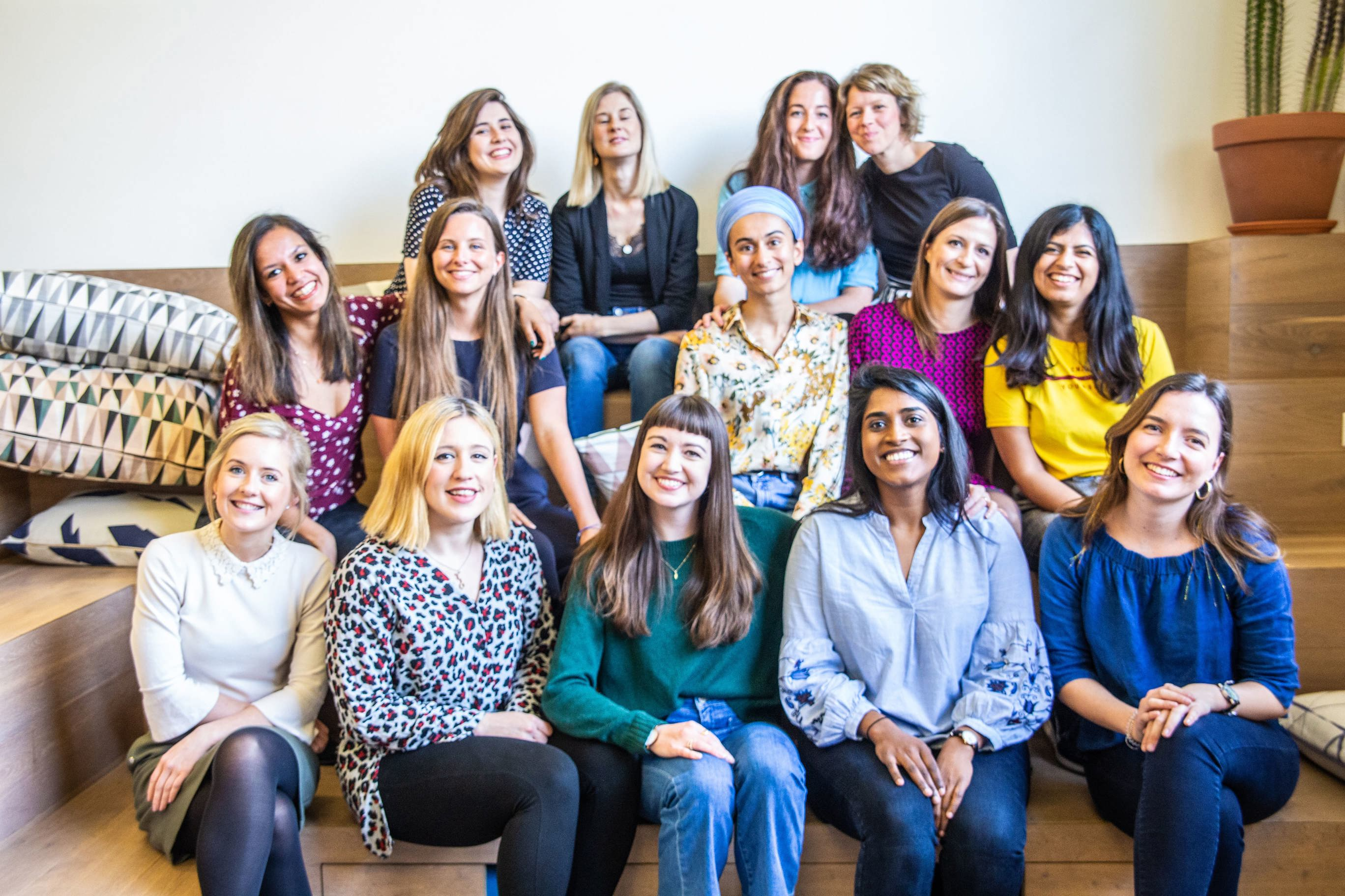 Group photo of The Girls Network staff smiling in their London offices