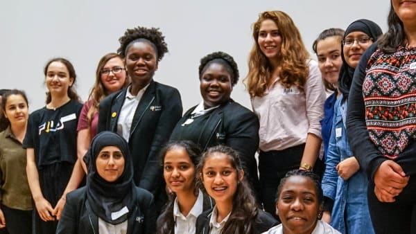 Photo of a London cohort of girls on stage at The Girls Network ambassador celebration