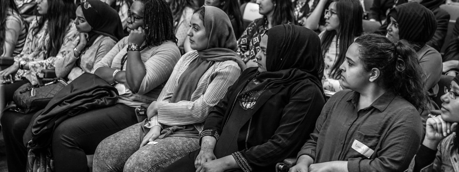 Photo of The Girls Network mentees sitting in audience at their ambassador celebration event