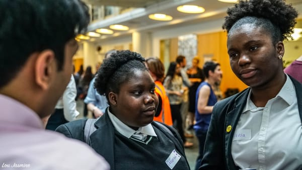 Photo of two The Girls Network mentees talking at a celebration event