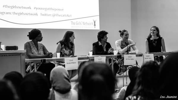 Photo of women sitting on a panel